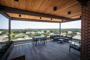 View of the rooftop balcony of 101 Nursery Lane with multiple seating arrangements and a view of downtown Fort Worth