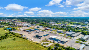 Zoomed-out aerial view of the Bear Cat Industrial Park consisting of four different industrial buildings