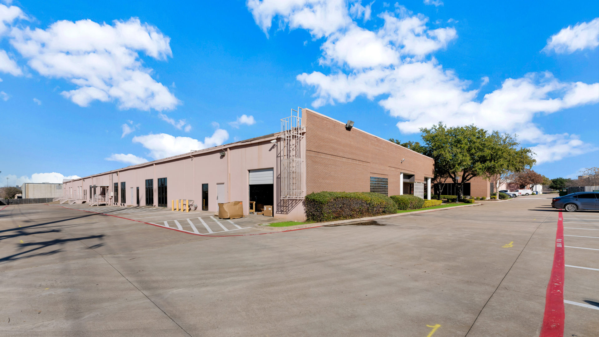 View of the backside of one building in the Avion Business Park with multiple garage doors and loading docks