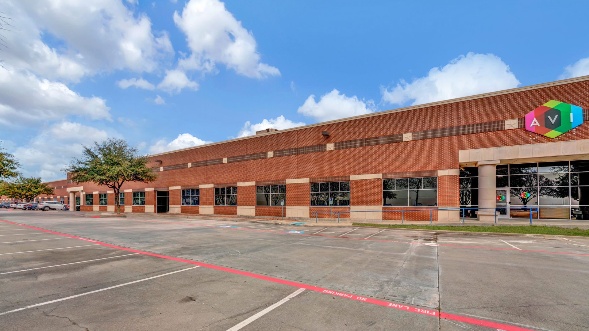 Side view of 4040 Royal Lane showing multiple parking spaces and the front entrance to the building