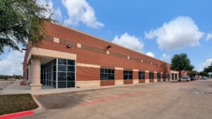 Corner view of 4040 Royal Lane, an industrial property owned by Fort Capital and located in Irving, TX