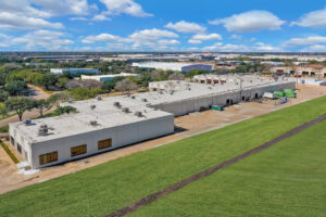Aerial view of the backside of 700 Industrial Boulevard showing multiple loading docks and space for truck parking