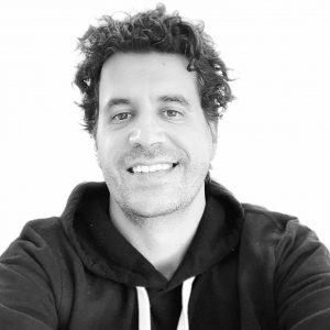 Headshot of Sean Sweeney in a black hoodie